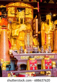 Shanghai, China - Nov 6, 2016: Inside the 600-year-old Old City God Temple. Altar statues of Taoist Deities are derived from famous ancient generals and judges. Low-light image.