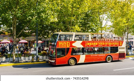 Shanghai, China - Nov 6, 2016: Along The Bund in a bus on Zhongshan Road East Road. Image features a parked double-decker tour bus.
