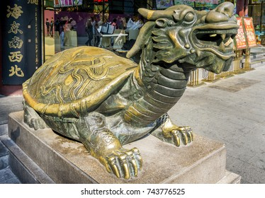 Shanghai, China - Nov 6, 2016: Closeup of a Chinese Qilin (Kirin in Japan) bronze statue standing guard at a public thoroughfare. This is a mythical creature of ancient Chinese legends.