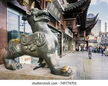 Shanghai, China - Nov 6, 2016: Bronze statue of Qilin (Kirin in Japanese) near the 600-year-old Old City God Temple. The mythical beast stands along Fangbang Middle Road.