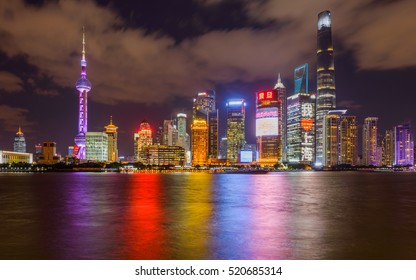 Shanghai, China - November 1, 2016: A night view of the skyscrapers of Lujiazui Pudong New Area at east bank of Huangpu River, looking from the Bund at west side of the river, in central Shanghai.