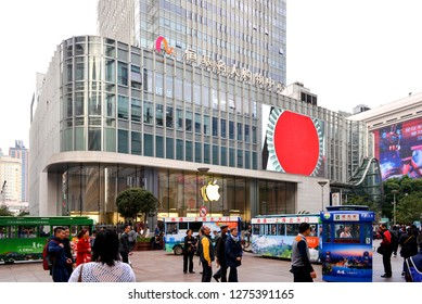 Shanghai, China - November 11, 2017:  Apple store on Nanjing East Road, a busy shopping district that is pedestrian only for some blocks.  A small fun train that transports people along the street.