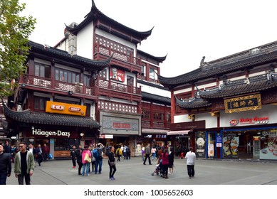 Shanghai, China - November 15, 2017: Popular American fast food outlets Haagen-Dazs, KFC and Dairy Queen restaurants with traditional Chinese architecture in Yu Garden area of the Old City of Shanghai