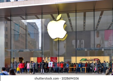 Shanghai, China - November 19, 2017:  A large crowd of people shopping at the Apple store on Nanjing East Road, a very busy shopping district.