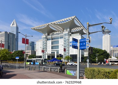 SHANGHAI, CHINA - NOVEMBER 2, 2017:  View of the People's Square area of the Huangpu District, including The Shanghai Grand Theatre, C, and The Radisson Hotel, R, on a sunny day.