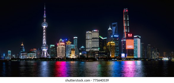 Shanghai, China - November, 2017 :Nightscape of Lujiazui skyline as seen from the Bund, across the Huangpu River, with the Shanghai Tower.