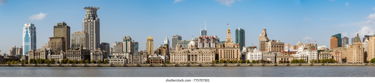 "Shanghai, China - November, 2017 :Wide Panorama image of Shanghai Waitan ""The Bund"". The Bund  or Waitan in Shanghai  is a waterfront area in central Shanghai."