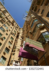 Shanghai/ China - November 23rd 2018: Looking up at an art deco building in the french concession of Shanghai with laundry hanging out to dry on a bright sunny day with a blue sky in the background