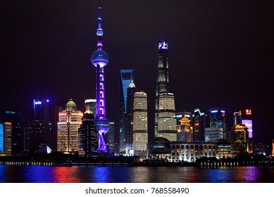 SHANGHAI, CHINA - NOVEMBER 4, 2017:  Night shot of the magnificent skyline of Shanghai Pudong area including the Oriental Pearl Tower, the Shanghai World Financial Centre and the Shanghai Tower.