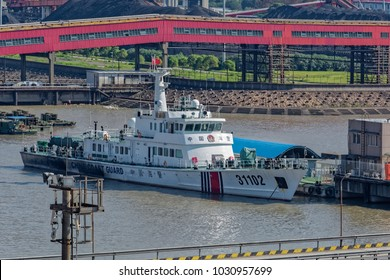 SHANGHAI, CHINA - Oct 08, 2017: Chinese Coast Guard (CCG) offshore patrol vessel No. 31102 berthed at the pier next to China's Biggest coal-fired power plant in Shanghai.