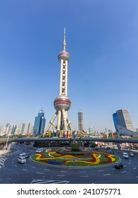 SHANGHAI, CHINA - OCT 24, 2014: The Oriental Pearl Radio & TV Tower is a TV tower in Shanghai. Its location at the tip of Lujiazui in the Pudong district makes it a distinct landmark in the area.