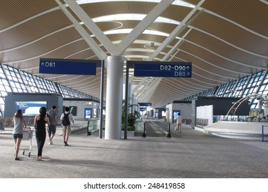 SHANGHAI, CHINA - OCT 24, 2014: Interior of the shanghai pudong airport. It is the primary international airport serving Shanghai, and a major aviation hub for Asia.
