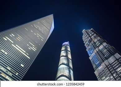 Shanghai, China - October 15, 2018: Low angle view of Shanghai Tower, world Financial Center and Jin Mao Tower in Shanghai.  These are the tallest buildings in Shanghai.
