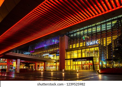Shanghai, China - October 15, 2018: One of the entrance of Shanghai world financial center at night time. Photo taken from Century Ave.