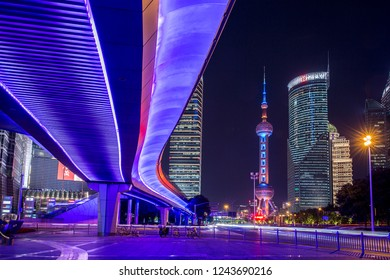 Shanghai, China - October 15, 2018: Shanghai street view with Oriental Pearl tower at night time.  Photo taken from Century Ave, outside of Shanghai world financial center.