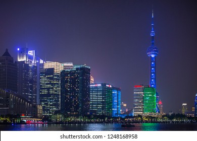 Shanghai, China - October 15, 2018:  Beautiful night view with Oriental Pearl Tower at Pudong New Area, Shanghai.  Photo was taken at Huangpu river.