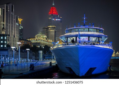 Shanghai, China - October 15, 2018:  A tour cruise is at the Huangpu River of Shanghai with beautiful cityscape night view at the background.