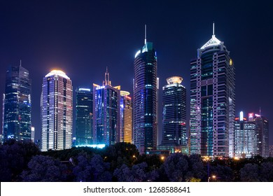 Shanghai, China - October 15, 2018: Modern buildings at Shanghai at night time.  Photo taken from Century Ave, outside of Shanghai world financial center.