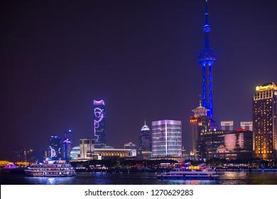 Shanghai, China - October 15, 2018:  Beautiful cityscape night view at Pudong New Area, Shanghai.  Photo was taken at Huangpu river.