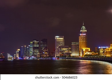 Shanghai, China - October 18, 2016: Night view to the riverside business center in Shanghai with night lighting advertising