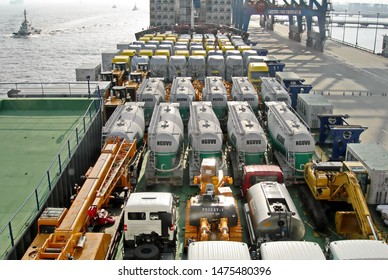 Shanghai, China, October 24, 2008. Loading heavy equipment and trucks aboard a Ro-Ro vessel in the port of Shanghai. Cargo securing and transportation.