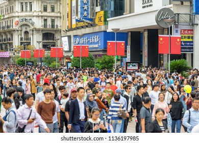 Shanghai, China - October 3, 2017: Crowd on Nanjing Road on the National Day holidays. Tourists and residents walking at downtown of Shanghai. Golden Week in China.