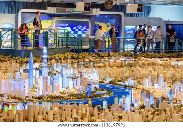 Shanghai, China - October 3, 2017: Visitors viewing a large scale model of the city in the Shanghai Urban Planning Exhibition Center. The model showing all existing and approved future buildings.
