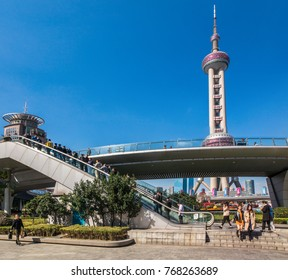 SHANGHAI, CHINA - OCTOBER 31, 2017: Oriental Pearl tower view with pedestrial aerial bridge