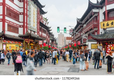 Shanghai, China - October 5, 2017: Tourists and residents walking at the Old City. View of Fuyou Road on the National Day holidays. Golden Week in China. Shanghai is a popular tourist destination.