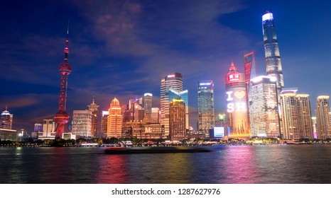 Shanghai, China - Ooc 11 , 2018 : night view of the modern Pudong skyline across the Bund in Shanghai, China. Shanghai is the largest Chinese city