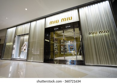 SHANGHAI, CHINA - Sept. JAN,9,2016: Miu Miu store at night. Miu Miu is Prada's secret weapon to win China's young luxury shoppers with its edgier image is propelling Prada's growth.