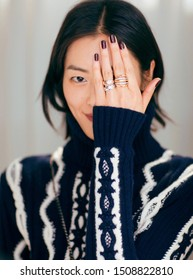 shanghai, china- september 12, 2019: Famous Chinese super model liu wen is wearing blue Chanel Sweater and COCO CRUSH Finger rings posing, sexy and pretty Chinese woman