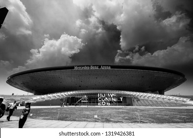 SHANGHAI, CHINA - SEPTEMBER 2, 2016: Attendees of Huawei Connect 2016 information technology conference near entrance to Mercedes-Benz Arena in Shanghai, China on September 2, 2016.