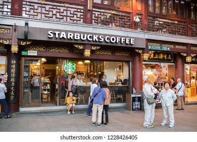 Shanghai, China: September 26, 2018: A Starbucks Coffee retail store in the Old City District of Shanghai, China.  Shanghai is the most populous city in China.