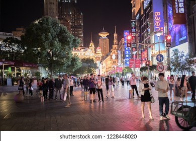 Shanghai, China: September 26, 2018:  Shoppers and pedestrians on Nanjing Road, the main shopping district in Shanghai, China.  Nanjing Road is a popular location for shopping, with many major brands.