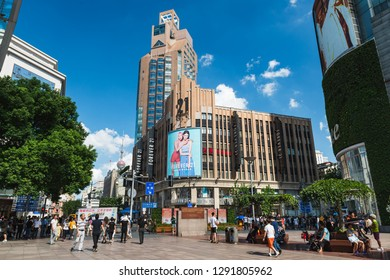 Shanghai, China - September 9, 2018: Tourists and shoppers pass through the popular shopping area of Nanjing Road in Shanghai, China.