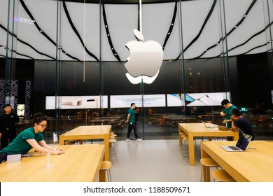 SHANGHAI CHINA-April 30, 2018: consumers try Apple electronics at Apple flagship store on Nanjing road pedestrian street. Apple Inc. is a high-tech company in America, headquartered in California.