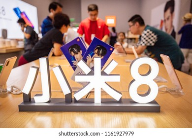SHANGHAI CHINA-August 22, 2018: Consumers buy mobile phones, computers, rice cookers, sweeping robots, wireless routers, color TV sets, VR glasses and other electronic products at a XIAOMI store.