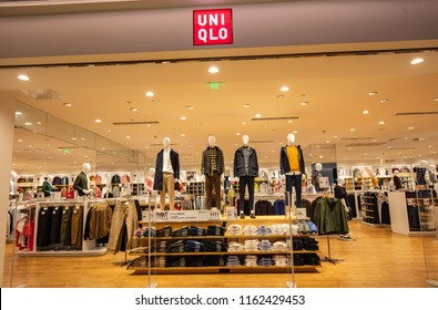 SHANGHAI CHINA-August 22, 2018: Shanghai Uniqlo textile and clothing retail chain stores, large LOGO and clothing on the window. Founded in 1963, it is an internationally famous clothing brand.