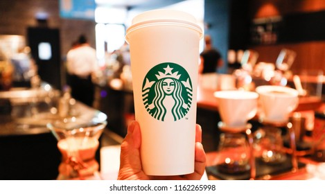 SHANGHAI CHINA-August 22, 2018: Urban white-collar workers take a break from a coffee drink at a Starbucks selection store in Pudong New Area. Starbucks, the US company, is the largest coffee chain.
