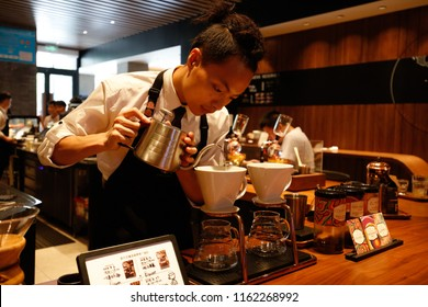 SHANGHAI CHINA-August 22, 2018: A waiter grinds coffee beans for consumers at a Starbucks selection store in Pudong New Area. Founded in 1971, Starbucks is the largest coffee chain in the world.