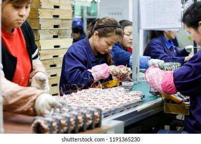 SHANGHAI CHINA-March 17, 2018: an electrical factory worker is exporting electronic products to the United States and the European Union. China's Manufacturing Purchasing Managers Index (PMI) is 50.8%