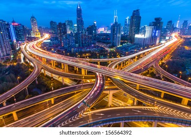 SHANGHAI - CIRCA APRIL 2013 - Night skyline view of city and highways with flowing traffic, circa April 2013