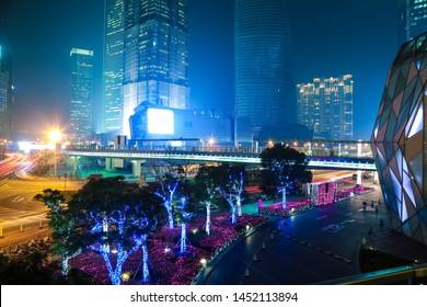 Shanghai city modern buildings background of street scene at night