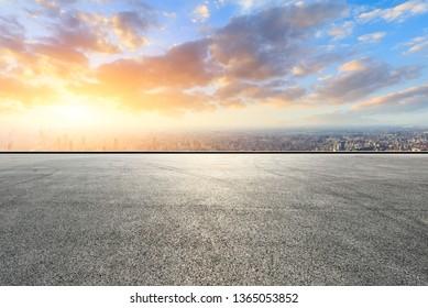 Shanghai city skyline and asphalt race track ground at sunrise,high angle view