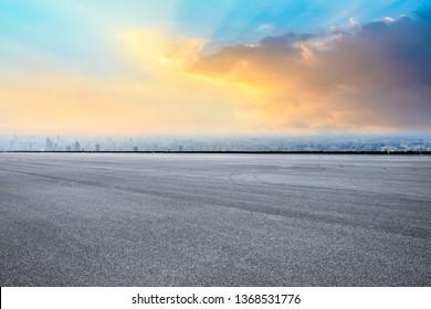 Shanghai city skyline and asphalt race track ground scenery at sunrise