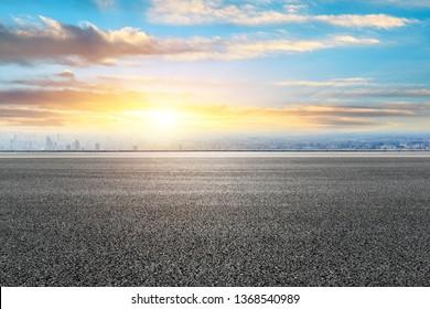 Shanghai city skyline and empty asphalt road ground scenery at sunrise