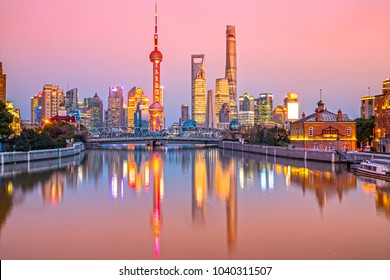Shanghai city skyline, view of the skyscrapers of Pudong and Waibaidu bridge from huangpu River. China.