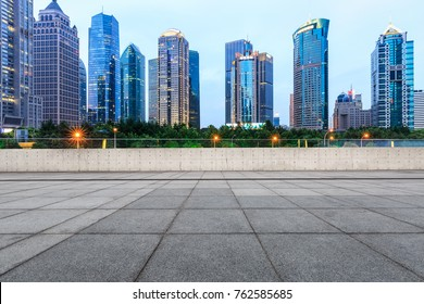 Shanghai city square and modern commercial building scenery at dusk,China