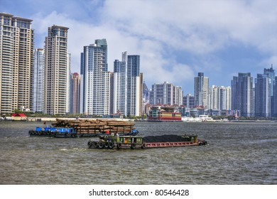 Shanghai - Coal and Timber Barges on the River Huangpu with Modern Buildings in the Background